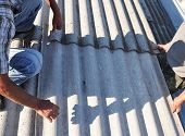 Roofer Repair and Replace Dangerous Asbestos Old Roof Tiles. Asbestos removal. poster