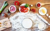 top view of different pizza ingredients vegetables and dough on wooden tabletop poster
