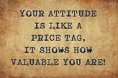 Inspiring motivation quote with typewriter text your attitude is like a price tag, it shows how valuable you are. Distressed Old Paper with Typing image. poster