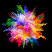 Explosion of colored powder, isolated on black background. Power and art concept, abstract blast of colors. poster