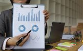Business person present to professional investor working new start up project. Finance managers meeting and discussion about analysis data on charts and graphs showing the results. Business finance accounting and marketing concept poster