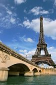 Vertical oriented photo of Eiffel Tower and fragment of bridge over the Seine River in Paris, France. poster