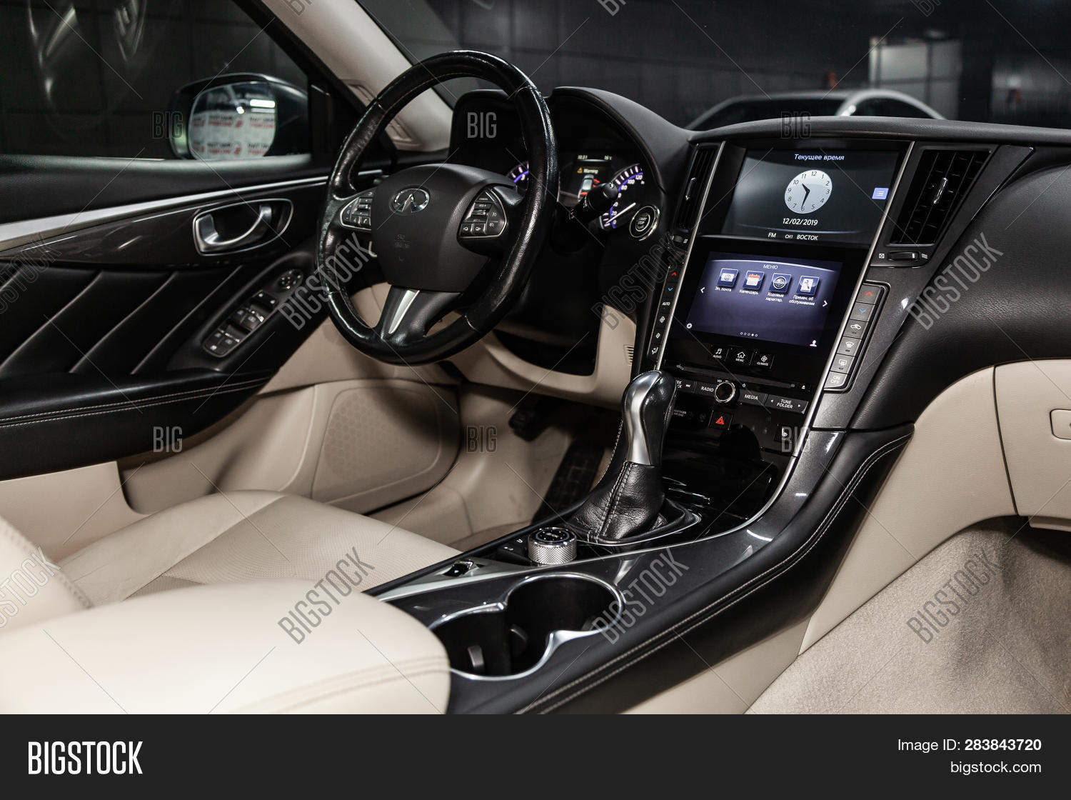 Novosibirsk Russia February 10 2019 Infiniti Q50 Close Up Of The Dashboard Sdometer Tachometer Seats And Steering Wheel