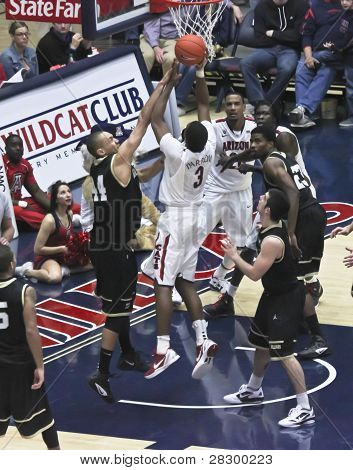 A Contested Layup By Arizona Wildcat Kevin Parrom