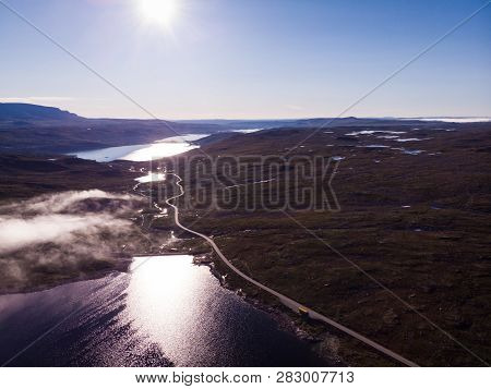 Aerial View. Road Crossing Hardangervidda Mountain Plateau, Clouds Over Lakes, Morning Time. Norway