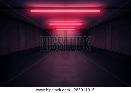 Dark Underground Room With Red Neon Light In Basement Or Parking Lot