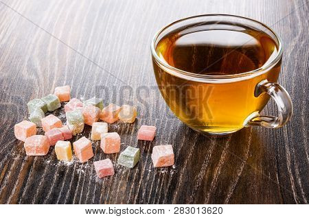 Cubes Of Multicolor Rakhat-lukum, Cup Of Tea On Dark Wooden Table
