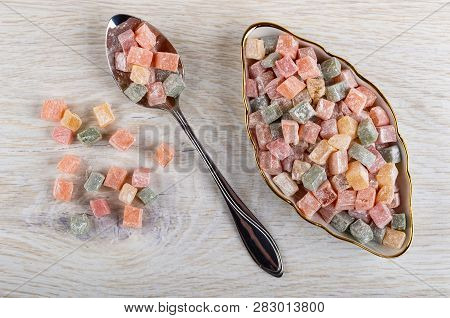 Cubes Of Multicolor Rakhat-lukum In Plate, Rakhat-lukum In Metallic Spoon, On Wooden Table. Top View