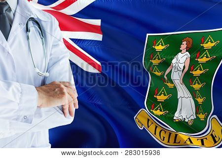 Doctor Standing With Stethoscope On British Virgin Islands Flag Background. National Healthcare Syst