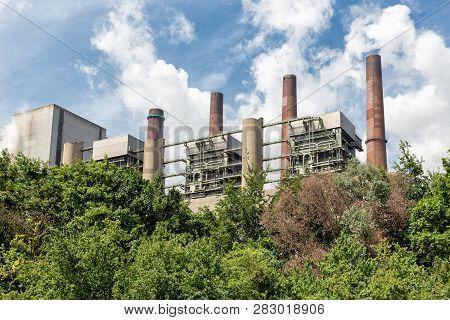 Smokestacks brown coal power plant in Germany near Bergheim poster