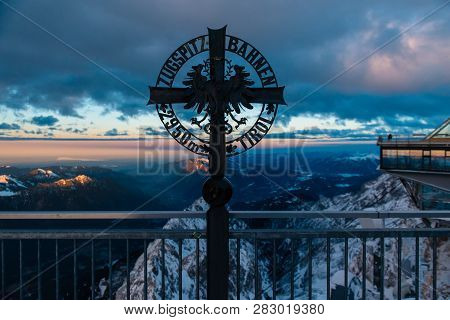 Summit Cross On Zugspitze Mountain In Bavaria, Germany, Europe. Evening Time
