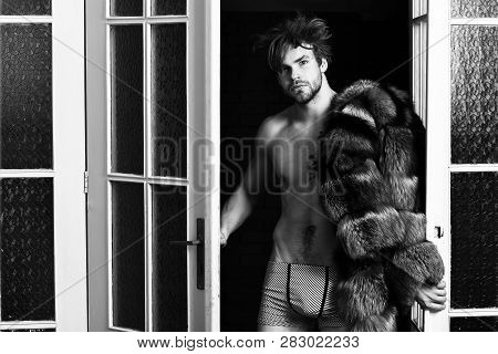 Luxury Status Symbol. Sexy Macho Tousled Hair Coming Out Bedroom Door. Richness And Luxury Concept.