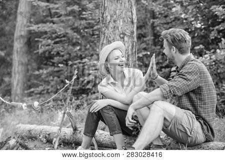 Couple Tourists Throwing Their Gesture While Sit Log Bonfire. Man And Girl Play Hand Gesture Game. C