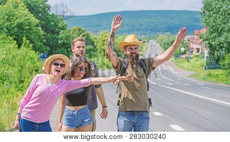 Friends Hitchhikers Travelling Sunny Day. Begin Great Adventure In Your Life With Hitchhiking. Compa