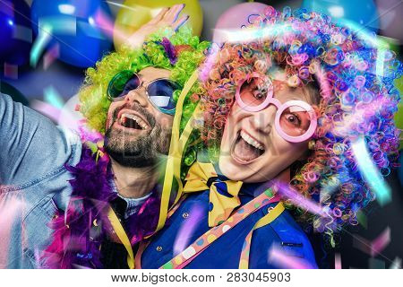 Women And Men Celebrating At Party For New Years Eve Or Carnival.