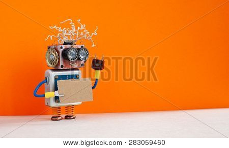 Funny Robot With A Cardboard Card Mockup. Creative Design Robotic Toy Holding A Blank And Empty Pape