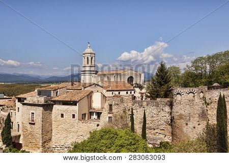 The Cathedral Of St Mary Of Girona, And The Old City Wall,  Girona, Catalonia, Spain.