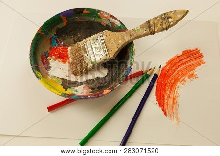 Wooden Painters Mixing Bowl With Wet Orange And White Paint Three Coloring Pencil Wet Paint Smeard O