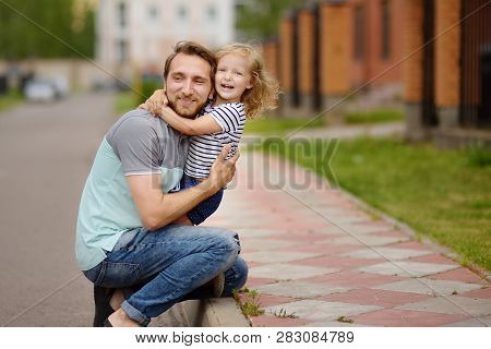 Young Happy Father Embracing Cute Little Daughter.love And Tenderness.. Quality Family Time.