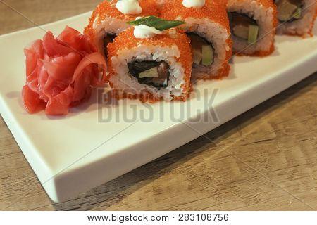 California Maki Sushi With Masago. Masago Outside