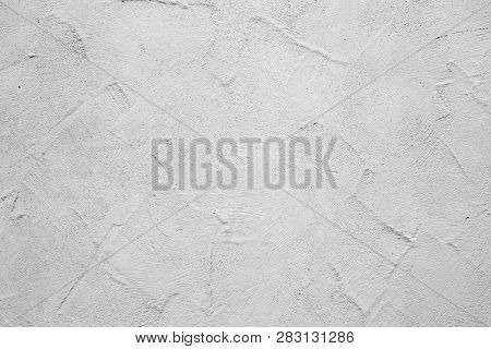 old structured plaster wall as harmonic background poster