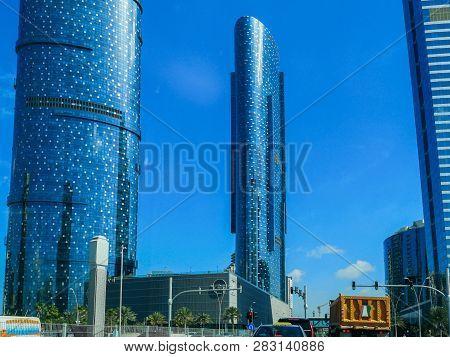 Top Aerial View Shot Of Al Reem Island Sun And Sky Towers And Landmarks In Abu Dhabi City, Uae - Abu