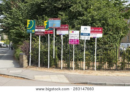 London, England - July 21, 2018. For Sale Signs On Display As Prices And Sales The Housing Market Pi