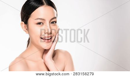 Beautiful Young Asian Woman With Clean Fresh Skin Look. Girl Beauty Face Care. Facial Treatment. Cos