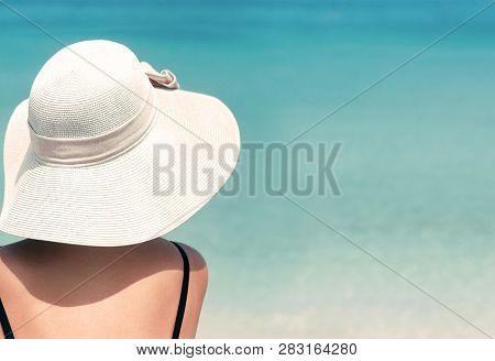 Happy Woman Enjoying Beach Relaxing Joyful In Summer By Tropical Blue Water. Beautiful Bikini Model
