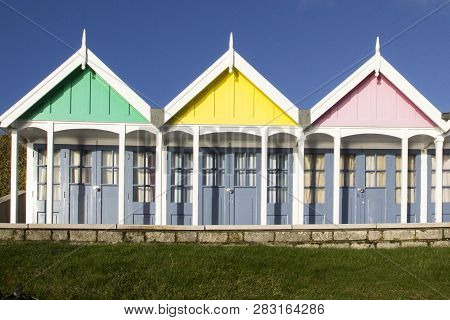 Weymouth, United Kingdom - December 26, 2017 - A Row Of Beach Huts In Sunlight Along The Esplanade P