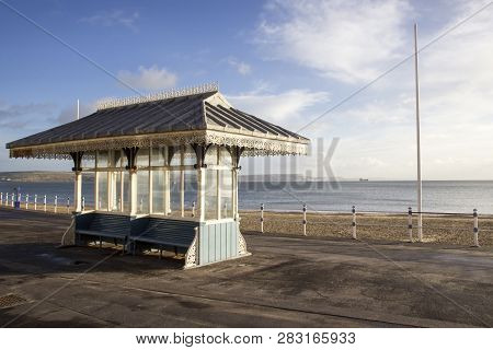Weymouth, United Kingdom - December 26, 2017 - Victorian Shelter Along The Esplanade Promenade With
