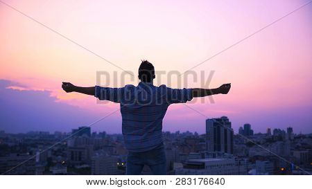 Man Stretching Hands On Roof Edge, Enjoying Freedom, Believe In Future Success, Stock Footage