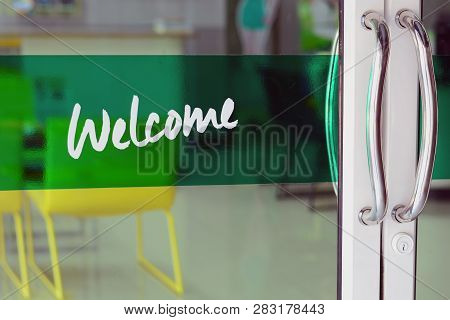 The Glasses Door With Welcome Letters On Green Label At Car Repair Shop