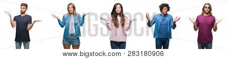 Composition of african american, hispanic and chinese group of people over isolated white background clueless and confused expression with arms and hands raised. Doubt concept.