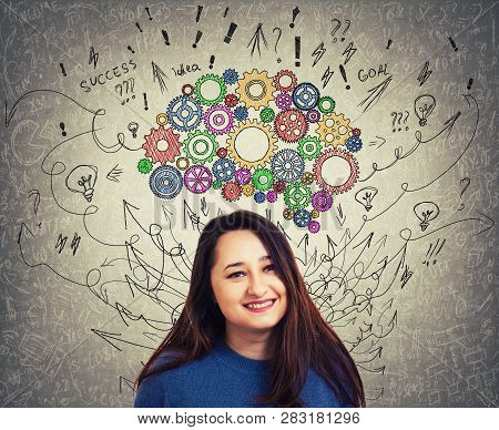 Close Up Portrait Of A Young Woman With Colorful Cogwheel Brain Above Head. Happy Emotion, Positive