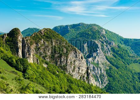 Beautiful Landscape Of Romania Mountains. Forested Hills And Huge Cliffs Of Canyon. Wonderful Nature