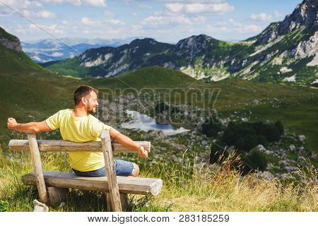 Traveler Mountains Rest Bench. Young Traveler Mountains Is Resting Sitting Wooden Bench. Hot Summer