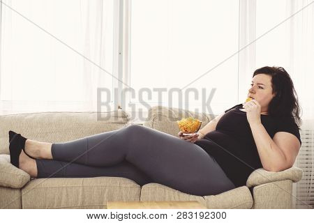 Lack Of Physical Activity, Sedentariness, Imbalanced Nutrition, Laziness, Homebody. Fat Woman Overea