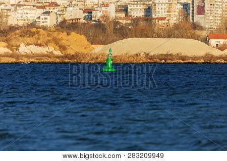 Navigation buoy from the river channel at the mouth of the river. Navigation buoy on the fairway of the river indicates the path for the passage of ships poster
