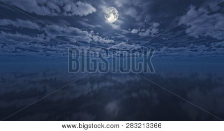 Amazing Moon And Cloudy Night Sky Reflecting In Still Waters.moon Over The Sea. Night Sky With Moon