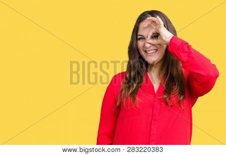 Beautiful plus size young business woman over isolated background doing ok gesture with hand smiling, eye looking through fingers with happy face.