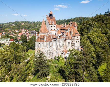 Bran Castle On A Hill With High Spires, Walls, Red Tiled Roofs, Surrounded By Bran Town, Wallachia,