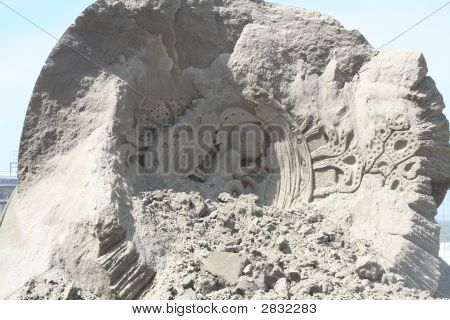 Sandsculpture Of An Embryo In The Uterus