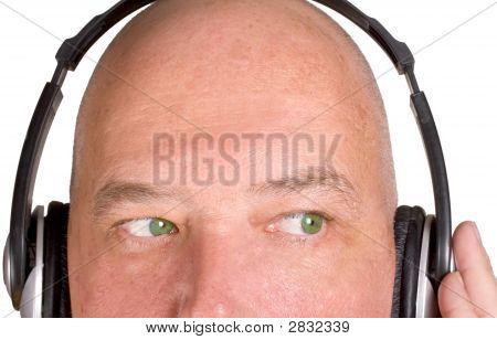 Male Listening To Music On Headpohones