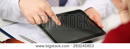 Male Doctor Hands Hold And Show Digital Tablet Pc To Patient Explaining Diagnosis. Physical Disease