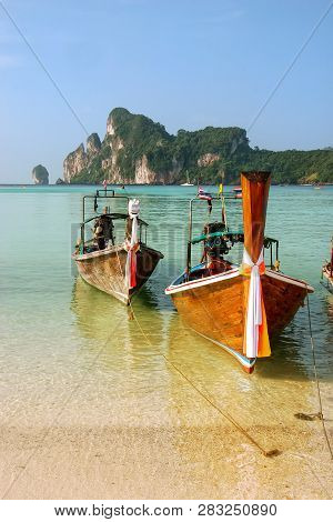 Longtail Boats Anchored At Ao Loh Dalum Beach On Phi Phi Don Island, Krabi Province, Thailand. Koh P
