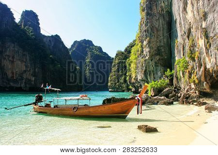Longtail Boat Anchored By Secluded Beach On Phi Phi Leh Island, Krabi Province, Thailand. Koh Phi Ph
