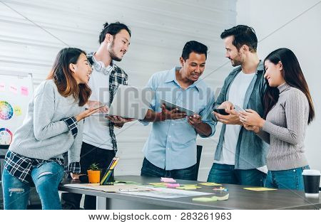 Diversity Designer In Casual Cloth Using Technology Device At Meeting Table In Meeting Room At Creat