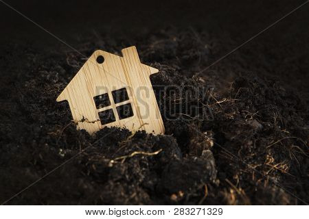 Wooden House Falls Into Ground. Under The Ground Home Mortgage, House For Sale, Real Estate Crisis C