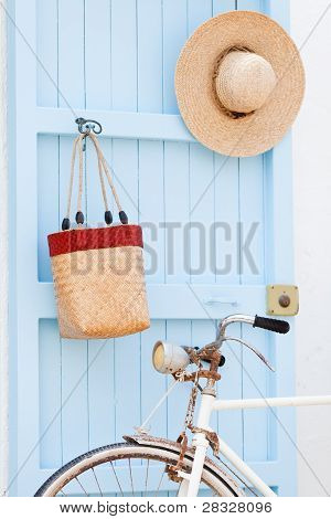 Old bicycle leaning against blue door.